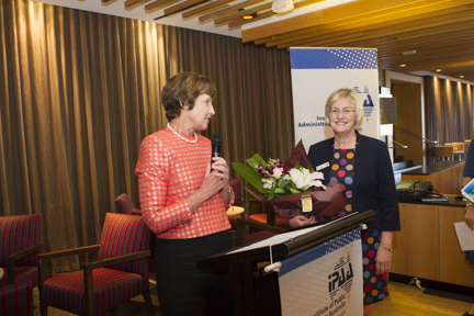 IPAA ACT president Glenys Beauchamp presents flowers to Alison Turner for her work in developing professional capability standards