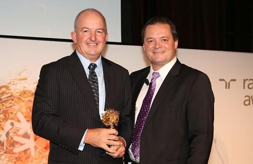 DIBP first assistant secretary Craig Farrell (left) accepting the award