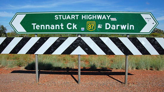 Green direction road sign at highway Australia outback