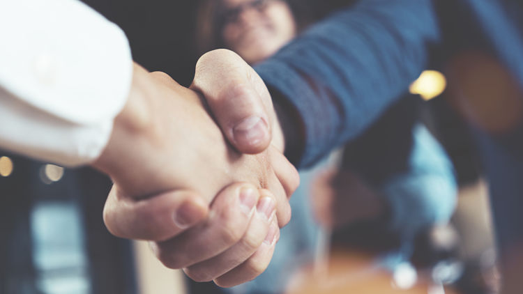 Business people shaking hands in the office after successful meeting.