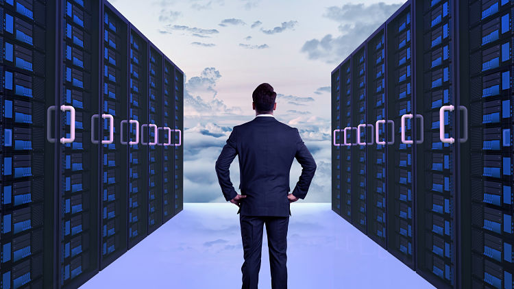 Rear view of a businessman standing at cloud server
