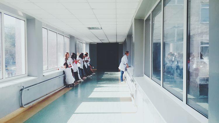 Doctors waiting outside hospital room