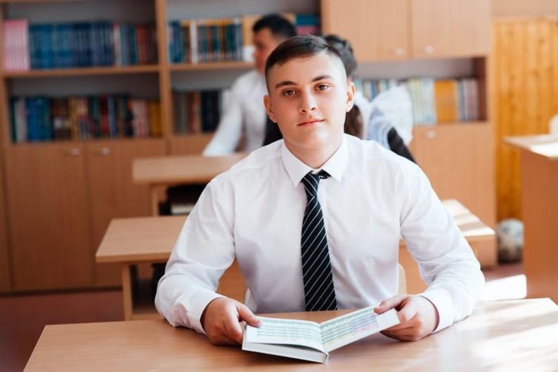 Private school boys in uniform at desks reading