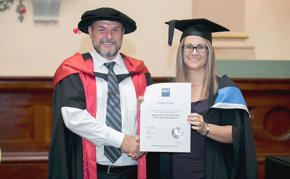 Kushla Wilson receiving her Graduation Certificate