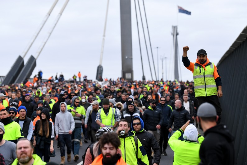 Protests boil over after Vic construction shutdown, NSW to increase workers on sites